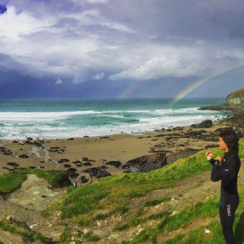 Surfer overlooking beach